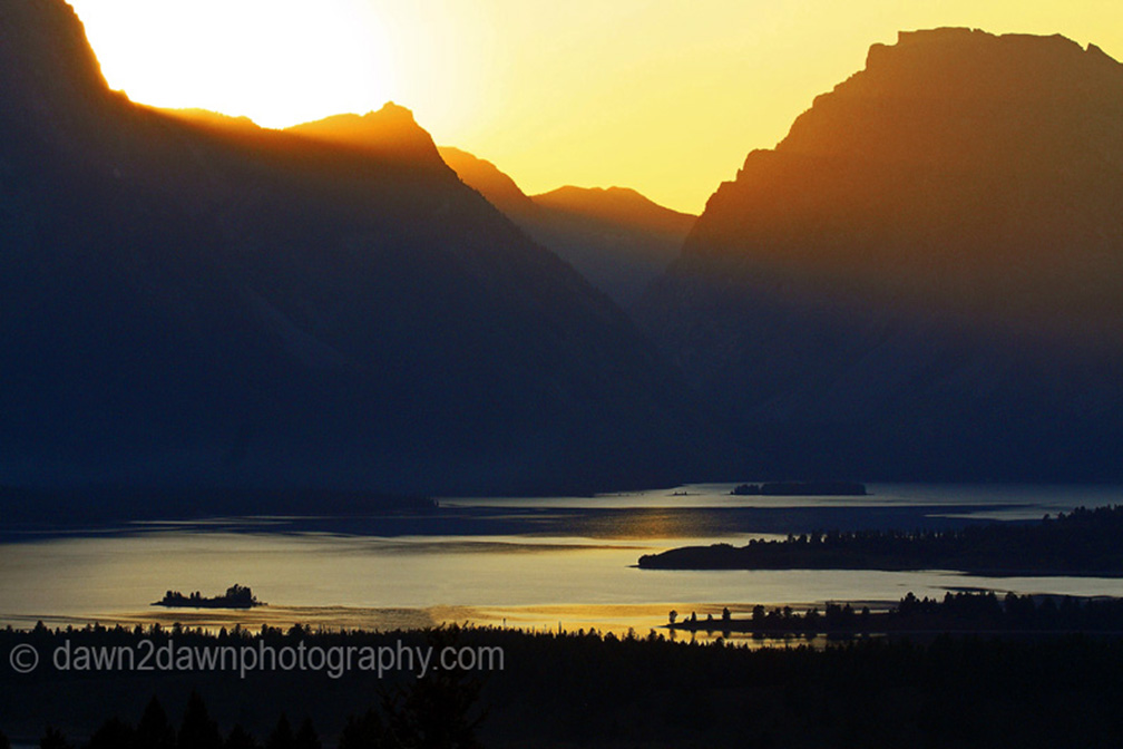 SUNSET OVER THE TETONS AND JACKSON LAKE