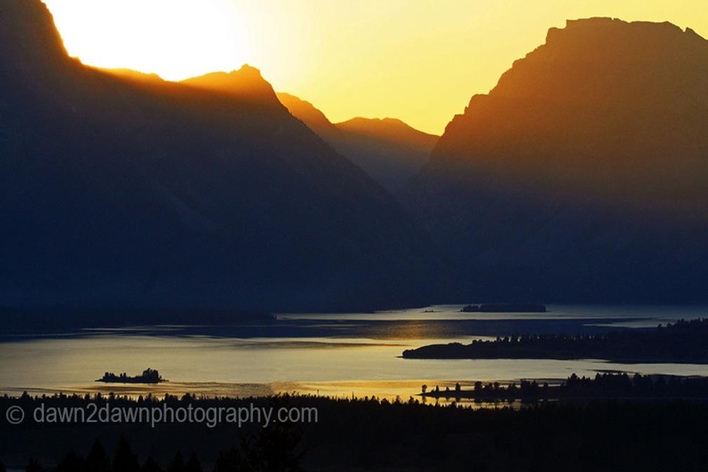 SUNSET OVER THE TETONS AND JACKSON LAKE