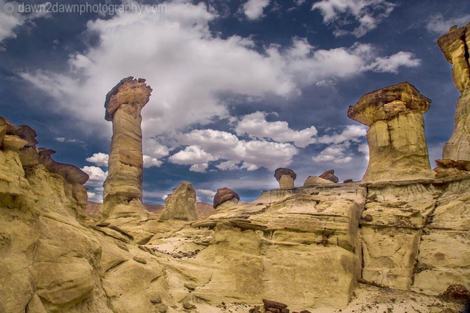 Sandstone walls and hoodoos carved through erosion make up the landscape at Wahweap Creek near Big Water, Utah