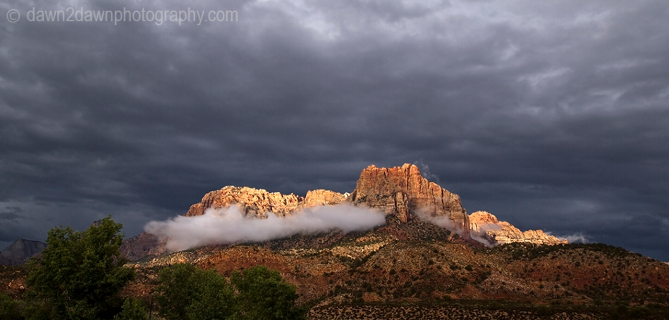 Passing storms bring rain and fog to the steep sandstone canyon walls at Zion National Park, Utah
