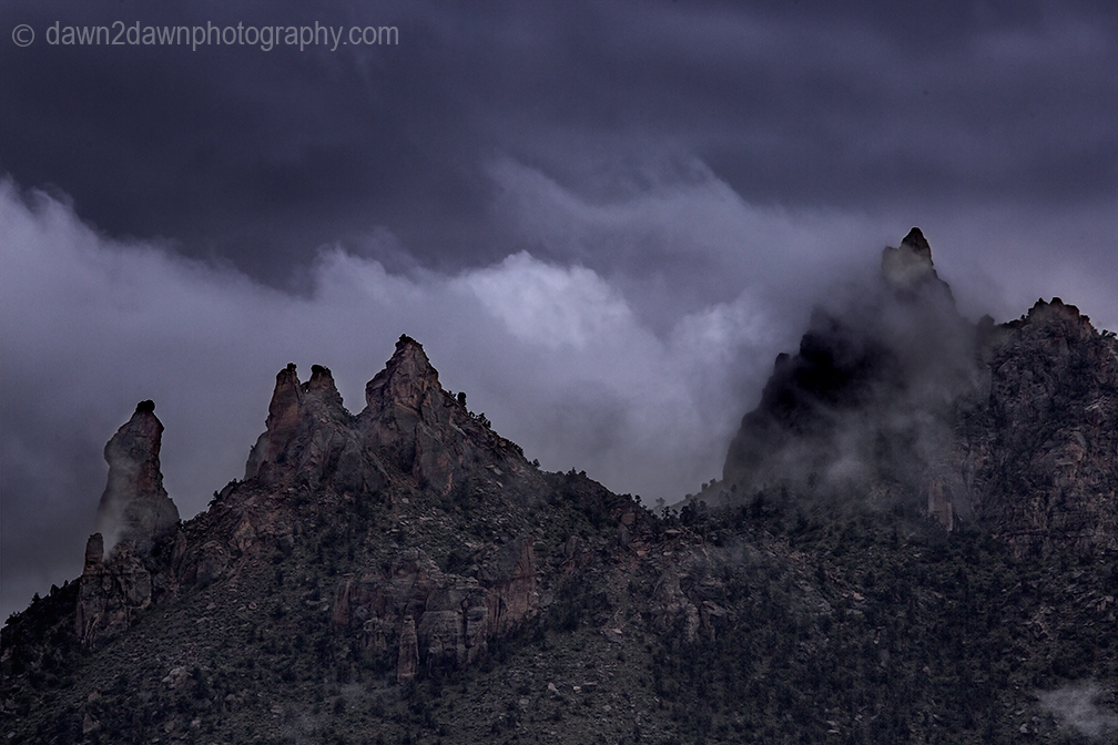 Passing storms bring rain and fog to the Eagle Crags just outside Zion National Park, Utah