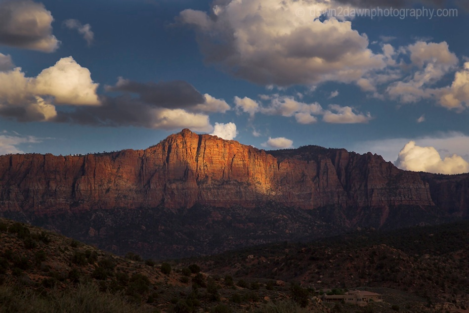 The sun sets on the sandstone walls near Zion National Park, Utah