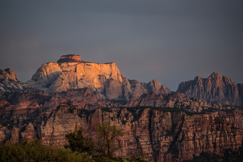 The sun sets on the West Temple as seen from Kolob Terrace at Zion National Park, Utah