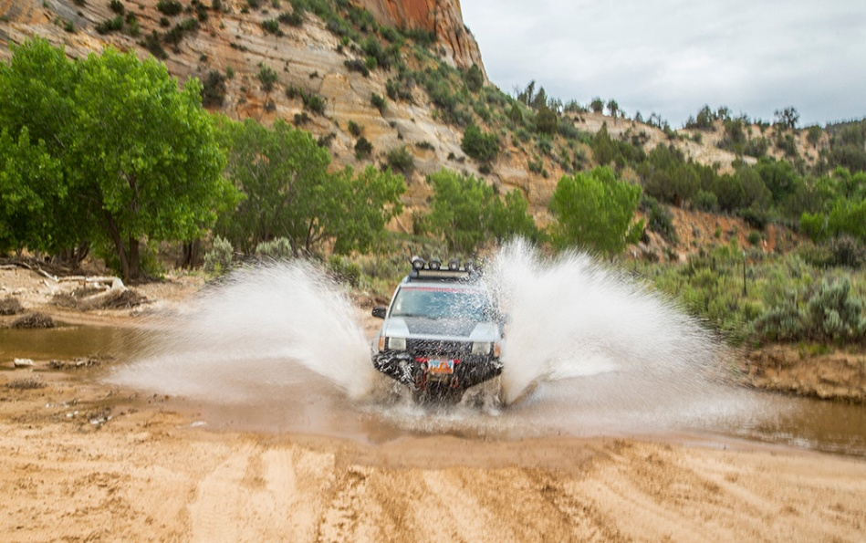 A four Wheel Drive Vehicle Fords The East ork Of The Virgin River in Southern Utah