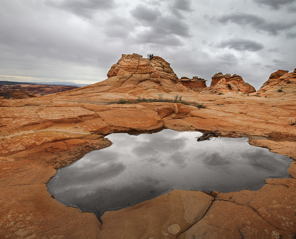 Clouds are reflected in the pools of water at South Coyote Buttes at Vermillion Cliffs National Monument, Arizona
