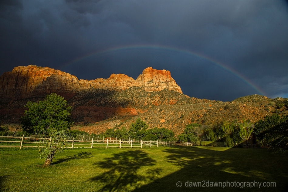 A thunderstorm passes through Zion Canyon and produces a rainbow at Zion National Park, Utah