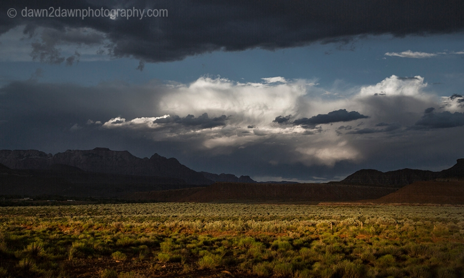 Storm clouds hover over the landscape near Zion National Park, Utah