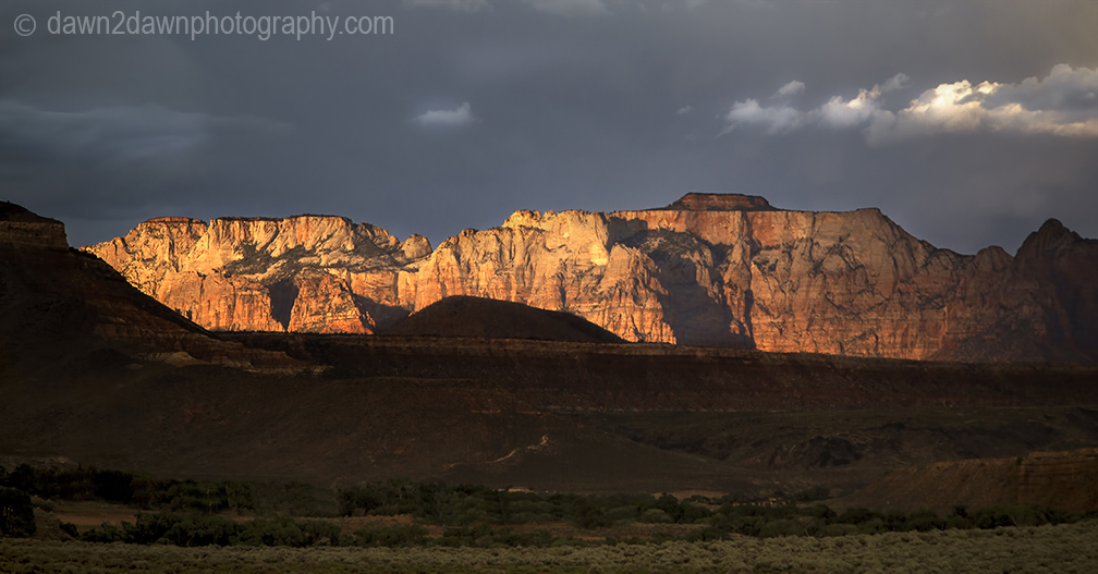 The sun sets on West Temple at Zion National Park, Utah