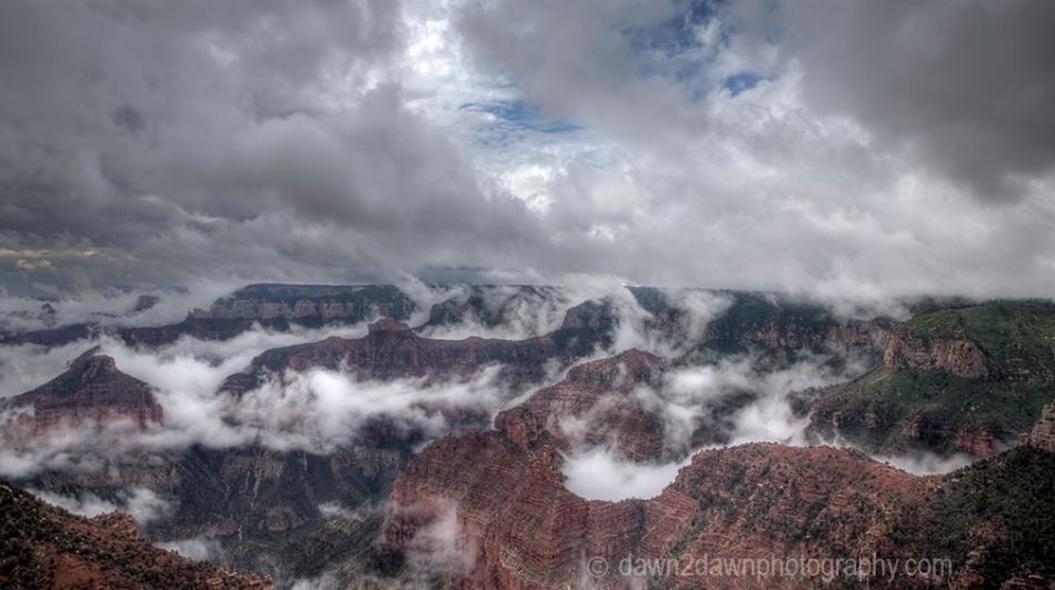 Fog lifts from the Bottom of The Grand Canyon from Point Imperial at Grand Canyon National Park, Arizona