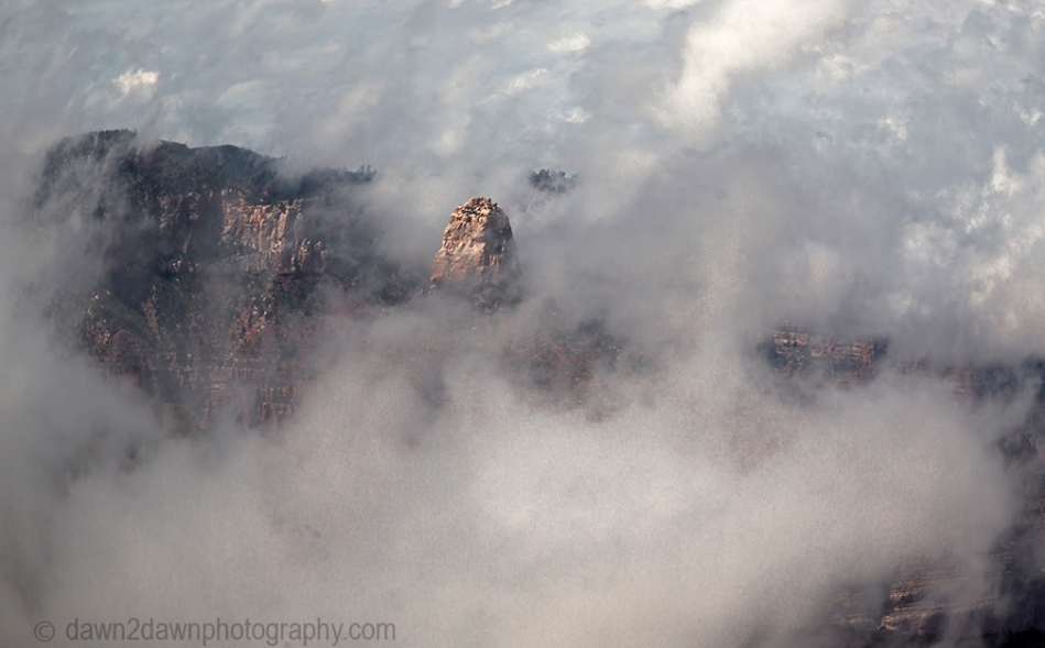 Fog rises from the depths of the Grand Canyon near Point Imperial at Grand Canyon National Park, Arizona