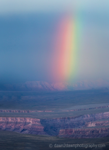 A rainbow appears during a thunderstorm at The Grand Canyon, Arizona