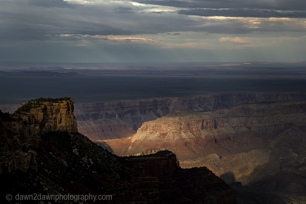 A thunderstorm passes through the Grand Canyon at sunset at Grand Canyon National Park, Arizona