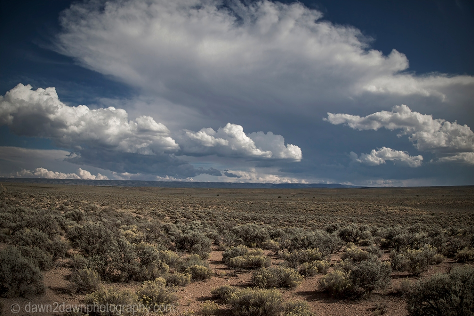 Storm clouds appear over the Northern Arizona landscape.