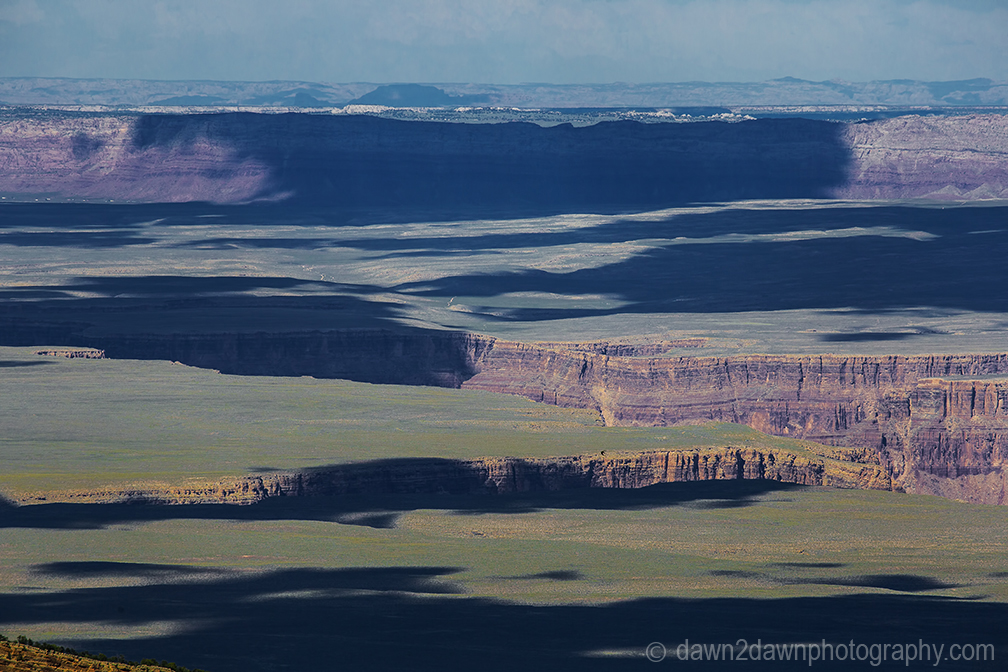 Passing clouds produce shadows on the landscape around Marble Canyon in Northern Arizona