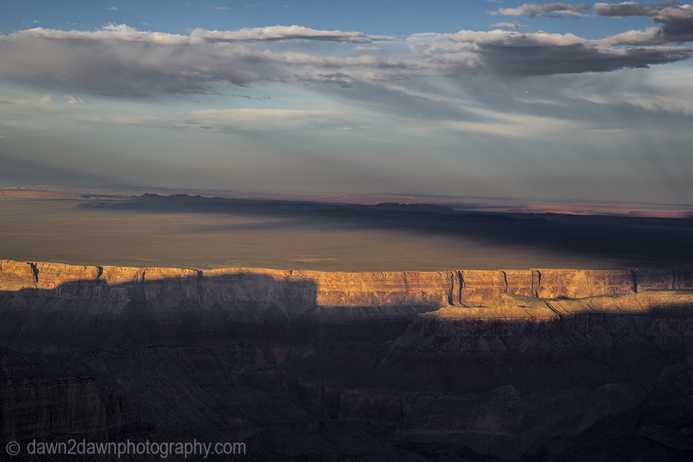 The settting sun forms shadows on the Grand Canyon at Point Imperial