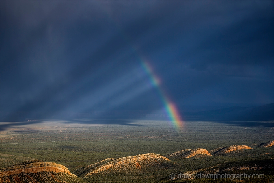 A rainbow appears during a monsoonal thunderstorm near the Grand Canyon in Northern Arizona