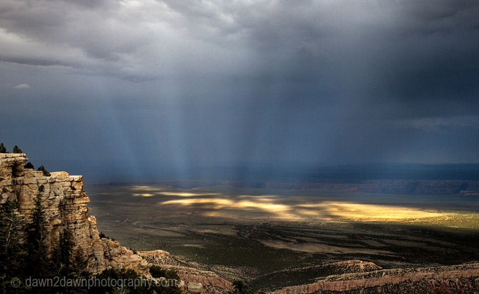 Shafts of light beam down onto the Northern Arizona landscape near the Grand Canyon