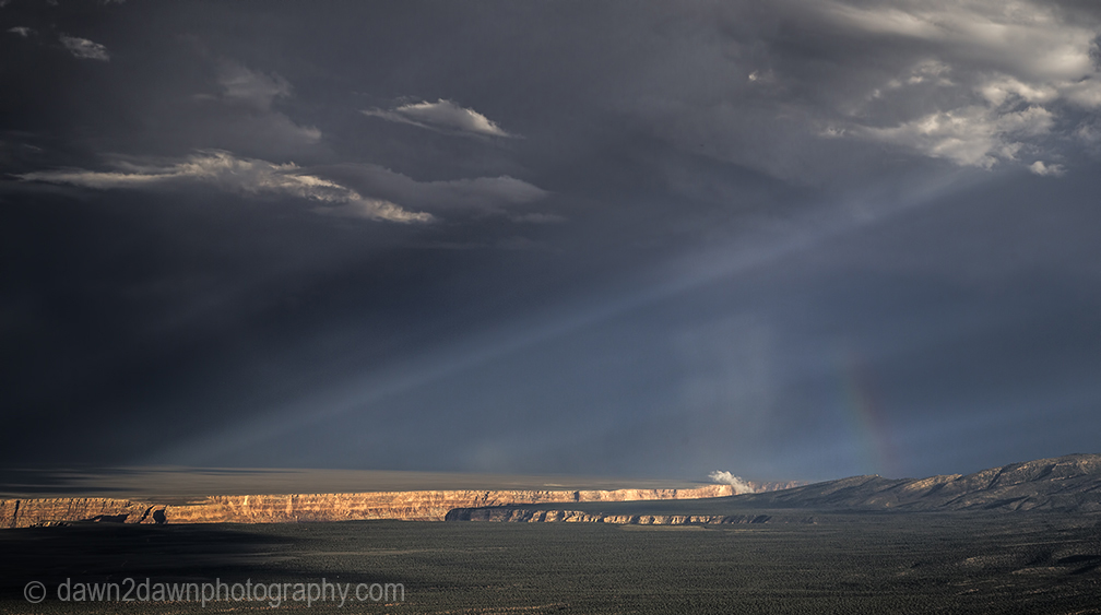 A monsoonal storm cell passes through the Northern Arizona landscape near The Grand Canyon.
