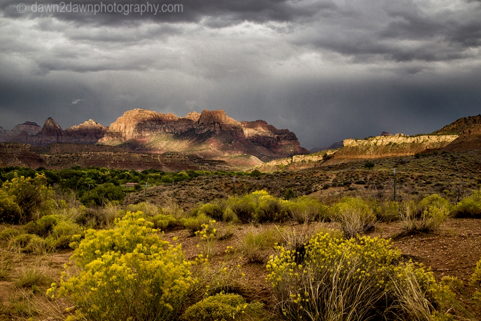 A storm approaches Zion National Park through The Watchman in Southern Utah