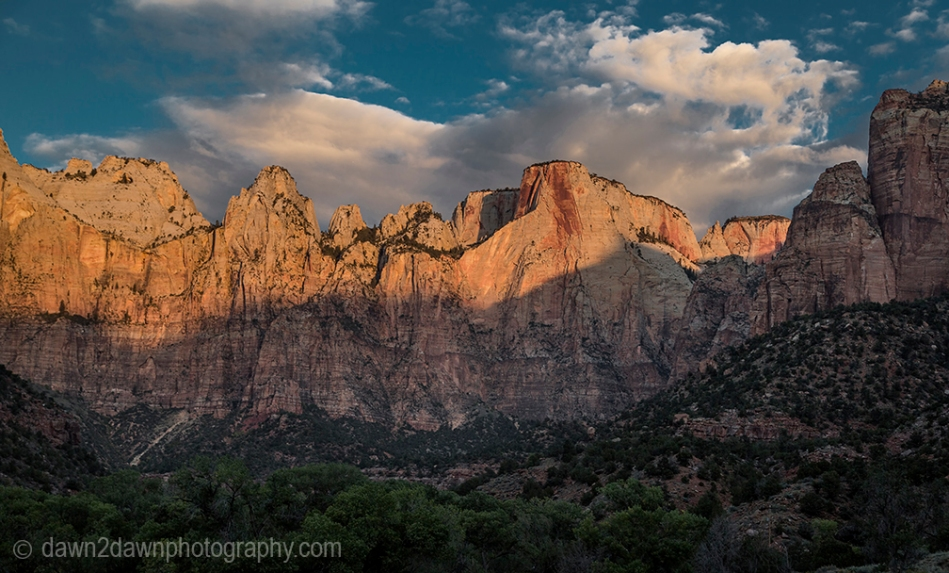 The sun rises on Zion National Park's Tower Of The Virgin