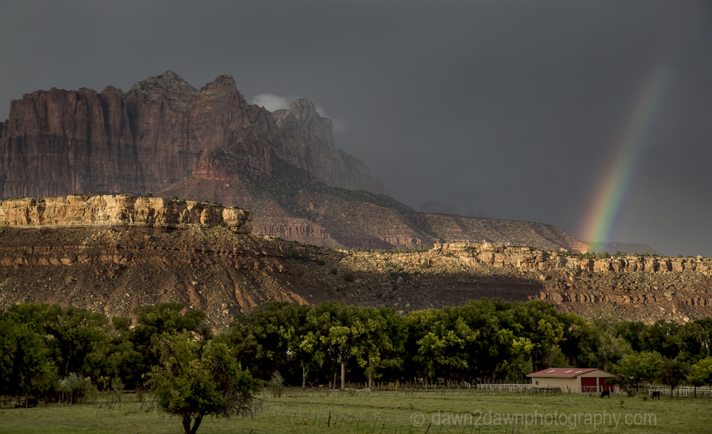 A storm approaches Zion National Park through West Temple in Southern Utah