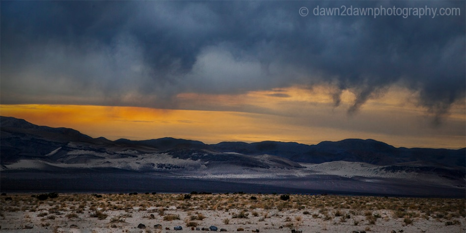 Storm clouds threaten Eureka Valley at sunset at Death Valley National Park, California