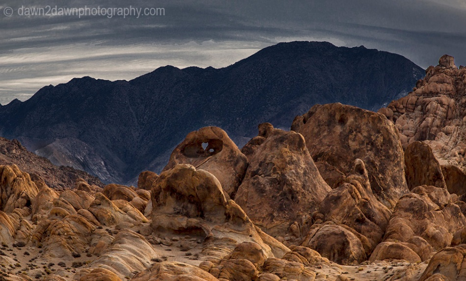 The sun rises over the eroded sandstone rocks of Alabama Hills in the Owens Valley of California