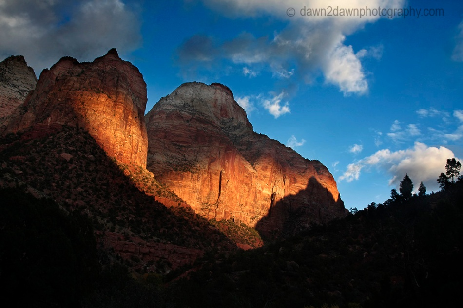 The sharp autumn sun sets on the sandstone walls at Zion.