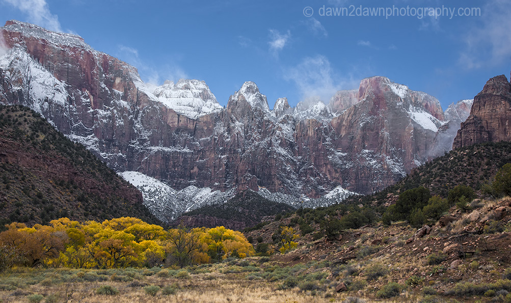 Fresh snow has fallen during autumn at Zion National Park's Towers Of The Virgin