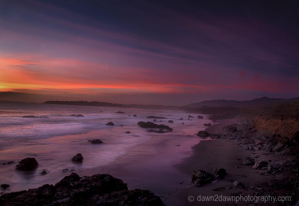 The sun sets over the Pacific Ocean near San Simeon, California