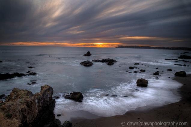 The sun sets along the California Pacific Coastline