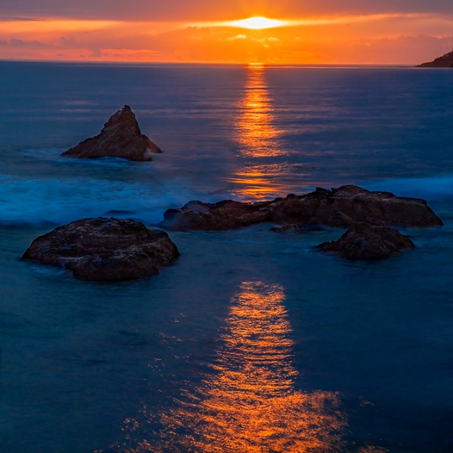 The sun sets along the California Pacific Coastline