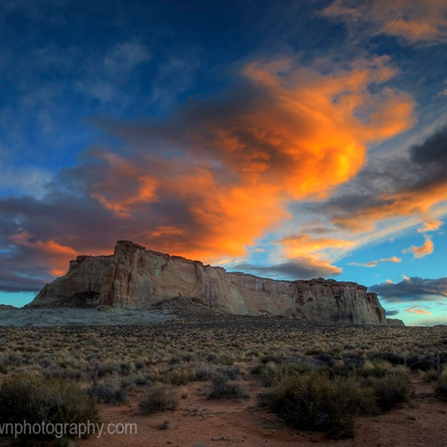 The setting sun fires up the clouds and landscape near Glen Canyon, Arizona