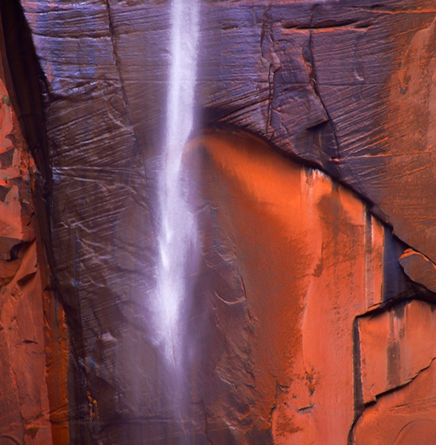 A seasonal waterfall appears out of nowhere at The Temple of Sinawava at Zion National Park, Utah