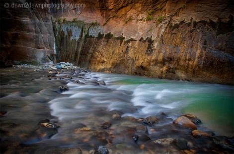 The Virgin River cuts through The Narrows at Zion National Park, Utah