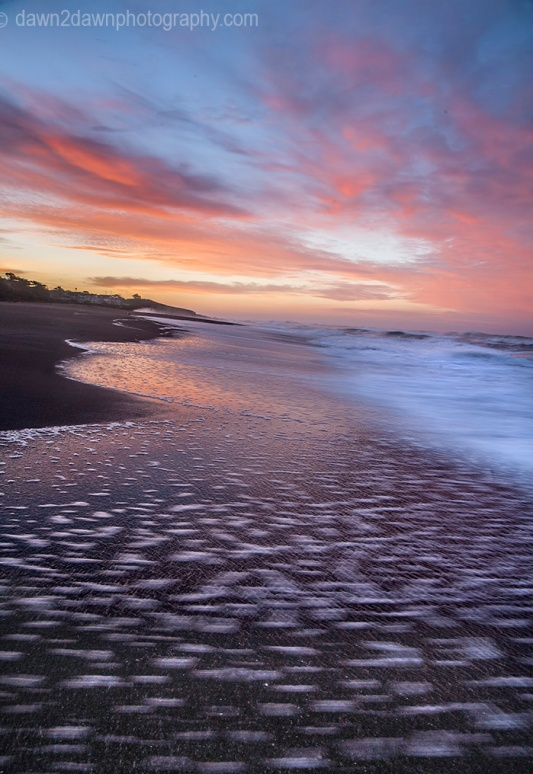 The sun rises over the Pacific Ocean at Cambria, California