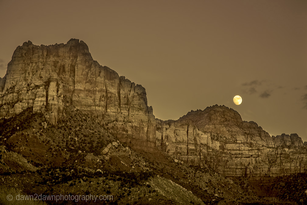 A full moon rises over the rim of Zion Canyon at Zion National Park,Utah