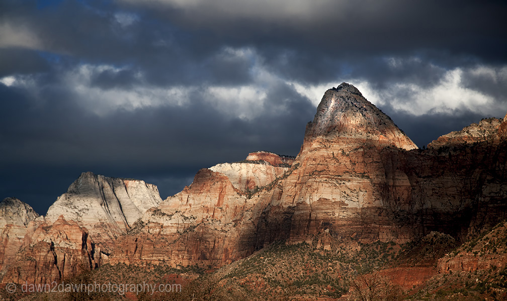 The sun sets on the sandstone walls of Zion Canyon at Zion National Park, Utah