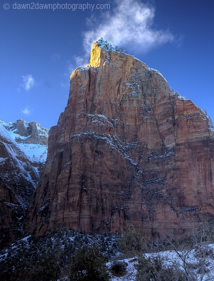 Fresh snow has fallen during winter at The Court Of The Patriarchs at Zion National Park, Utah
