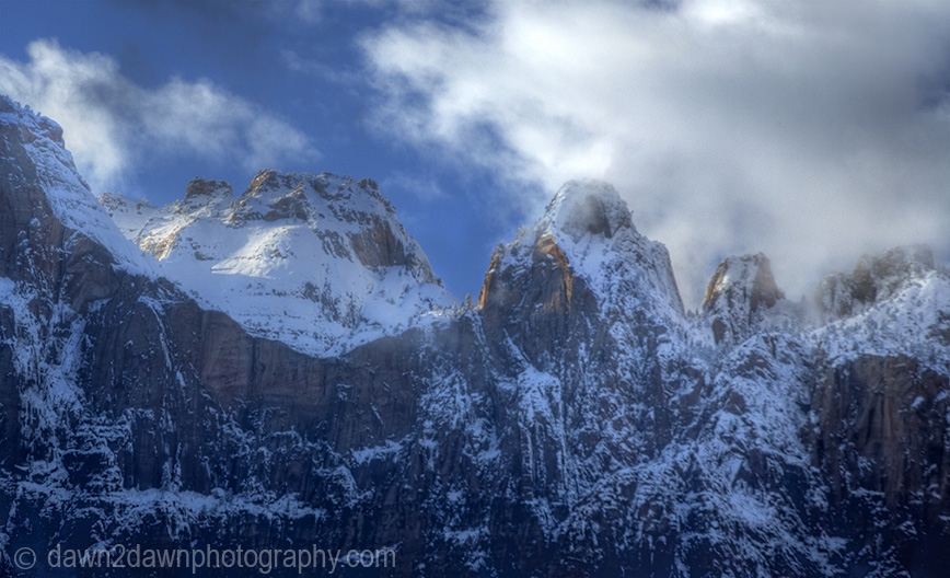 Fresh snow has fallen during winter at The Towers Of The Virgin at Zion National Park, Utah
