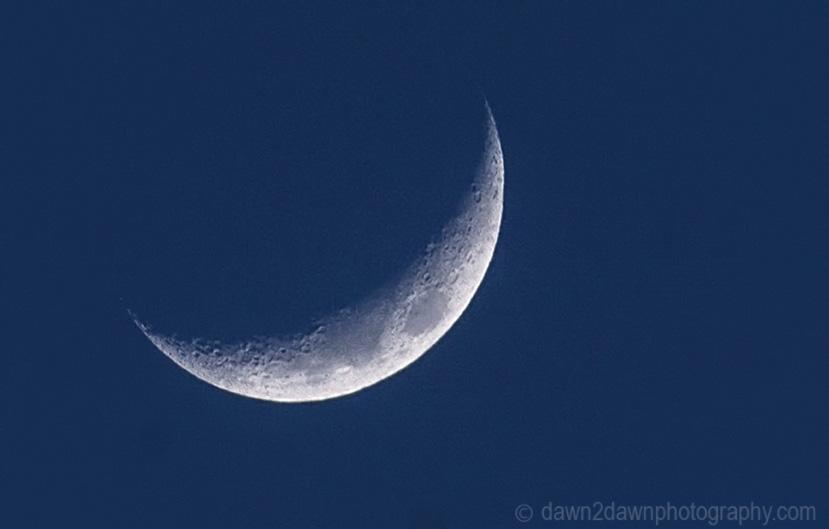 Closeup of a partial moon rising over California
