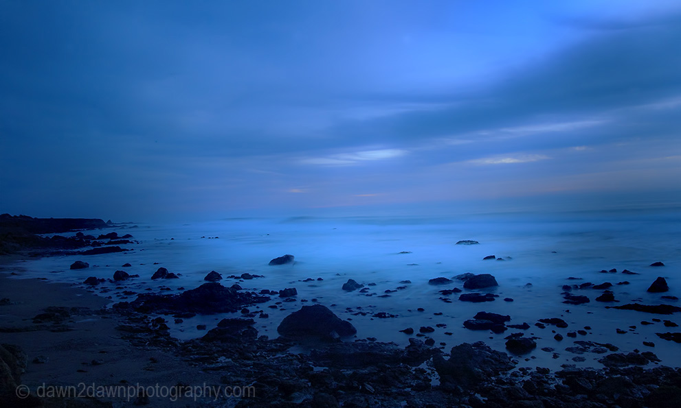 The sun sets over the Pacific Ocean at Cambria, California