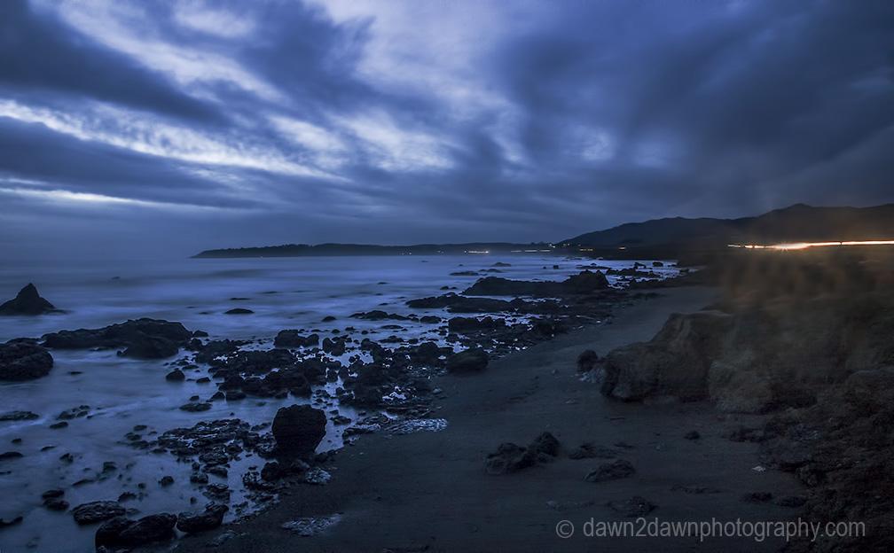 The sun sets over the Pacific Ocean at San Simeon, California