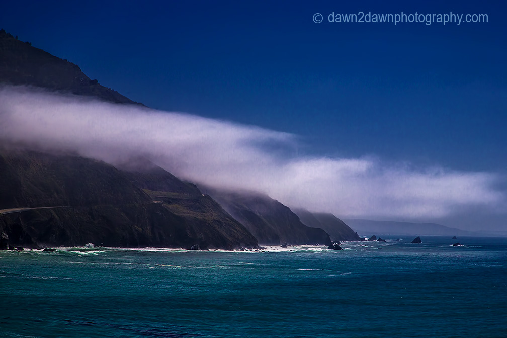 Fog rolls into the California Coast near Big Sur.