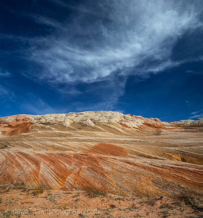 Wispy clouds hover over the sandstone anomalies at White Pocket at Vermilion Cliffs National Monument, Arizona