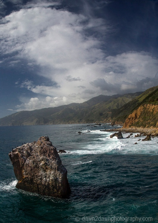 Waves pound upon the shoreline along California's Pacific Ocean Coastline near Big Sur.
