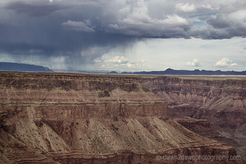 A thunderstorm passes along Marble Canyon at Grand Canyon National Park, Arizona.