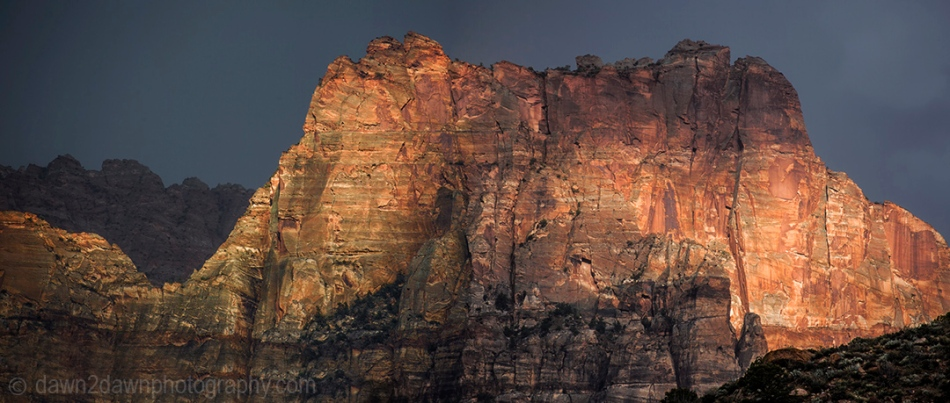 The sun sets on The Watchman at Zion National Park, Utah.