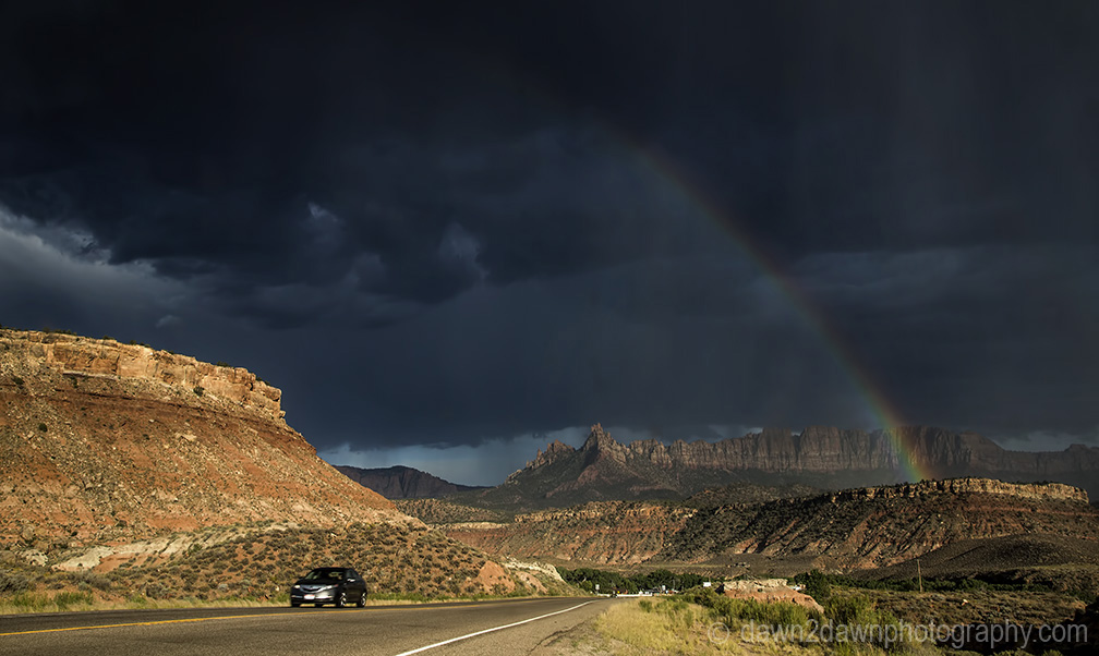 A rainbow appears during a thunderstorm at Eagle Crags near Zion National Park, Utah