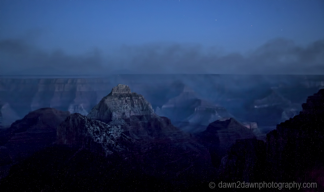 Light from a crescent moon brightens the Grand Canyon at Grand Canyon National Park, Arizona